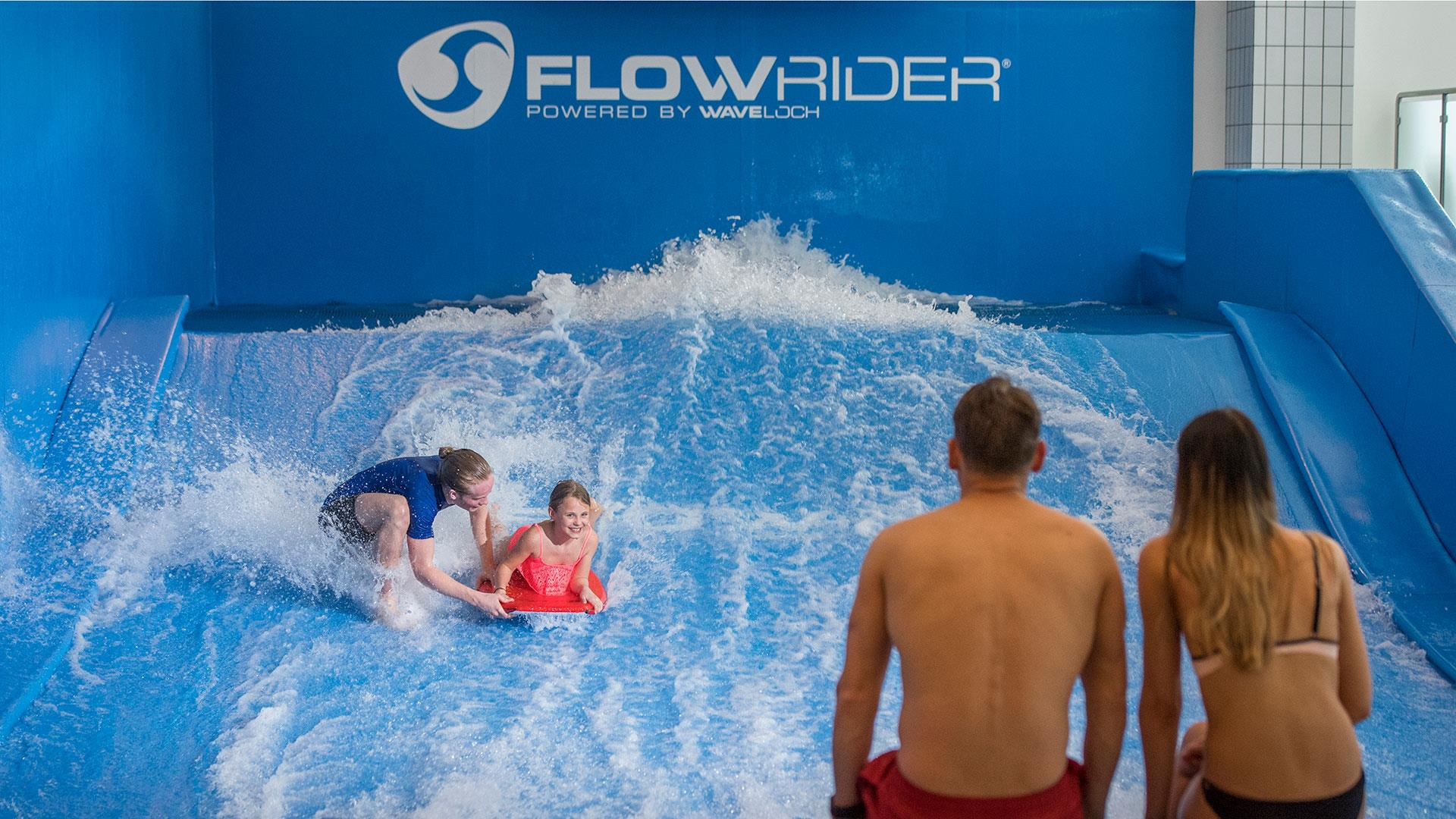 Picture of a couple watching their child surf indoors at Radisson blu in Trysil